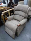 AN ELECTRONICALLY RECLINING LOUNGE CHAIR, IN SIMILAR FABRIC