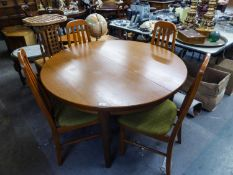 A G-PLAN MCINTOSH STYLE EXTENDING DINING TABLE WITH CIRCULAR TOP (124cm diameter) RAISED ON TAPERING