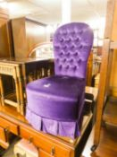 A BOUDOIR EASY CHAIR, BUTTON UPHOLSTERED IN PURPLE VELVET
