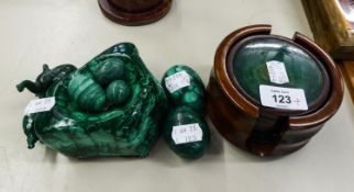 SET OF SIX WOOD AND MALACHITE COASTERS NESTING IN A WOODEN HOLDER; FIVE MALACHITE 'EGGS' IN SIZES;