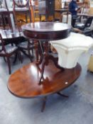 A REGENCY STYLE MAHOGANY OVAL OCCASIONAL TABLE, ON QUARTETTE SUPPORTS AND A CIRCULAR DRUM TOP