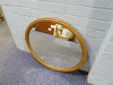 VICTORIAN OVAL BEVELLED EDGE WALL MIRROR, IN REED AND RIBBON GILT FRAME