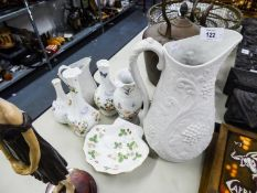 TWO PORTMERION PORCELAIN 'BRITISH HERITAGE' WHITE BISQUE GRADUATED JUGS, FRUITING VINE EMBOSSED, 11""