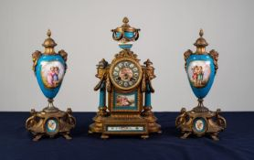 A LATE NINETEENTH CENTURY FRENCH GILDED SPELTER AND SEVRES STYLE PORCELAIN COMPOSITE THREE PIECE