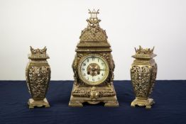 EARLY 20th CENTURY ORNATE AND CAST AND PIERCED BRASS THREE PIECE CLOCK GARNITURE, having spring