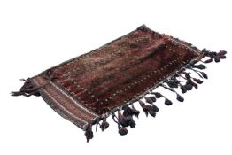 "TURKOMAN TRIBAL SADDLE BAG, with striped design in dark red/ brown and black, 39"" x 22"" (99cm x"