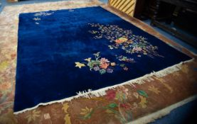 WASHED CHINESE CARPET, plain dark blye with scattered multi-colour spray, sprigs and foliage, 12ft x