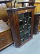 GEORGE III MAHOGANY FLAT FRONTED CORNER CUPBOARD, of typical form with dentil moulded cornice,