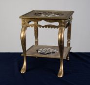 NINETEENTH CENTURY BRASS FOOTMAN, of typical form with stylised floral pierced centres to the top an