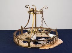 EDWARDIAN BRASS THREE LIGHT ELECTROLIER, with circular, pierced border and tasselled silk fringe,