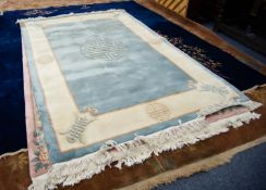 HEAVY QUALITY EMBOSSED WASHED CHINESE CARPET, the plain pale blue field having grey mon medallion,
