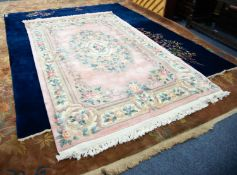 HEAVY QUALITY EMBOSSED WASHED CHINESE CARPET OF AUBUSSON DESIGN, on a plain pink field, large oval