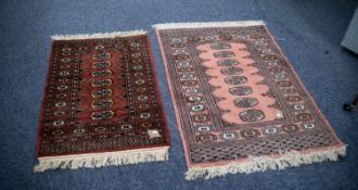 PAKISTAN 'BOKHARA' SMALL RUG with a single row of seven guls, on a wine red field, repeat pattern