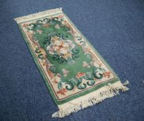 HEAVY QUALITY WASHED CHINESE RUG with embossed off-white and floral centre oval medallion and shaped