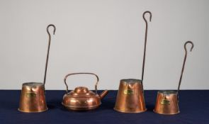 THREE GRAUDATED COPPER CIDER MEASURES with pouring lip and steel handle, also A SMALL COPPER TODDY
