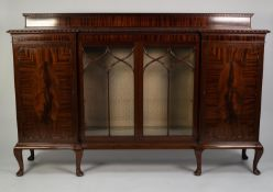 EARLY TWENTIETH CENTURY FIGURED MAHOGANY INVERTED BREAKFRONT DISPLAY CABINET, the shaped top with
