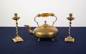 VICRTORIAN BRASS TODDY KETTLE of squat circular form with raised amber glass handle and on four