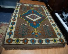 CAUCASIAN STYLE EASTERN RUG having diamond shaped centre concentric medallion with pendants on a