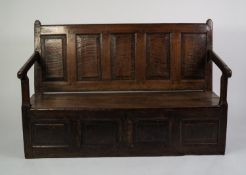 EIGHTEENTH CENTURY OAK BOX SETTLE, of typical form with five panel back, sloping arms and plank