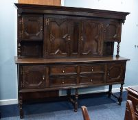 MID/ LATE TWENTIETH CENTURY JACOBEAN STYLE OAK LARGE SIDEBOARD, the canopy back with a central