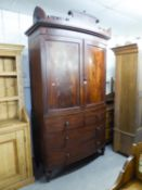 NINETEENTH CENTURY FIGURED MAHOGANY AND EBONY LINE INLAID BOW FRONTED LINEN PRESS, the castellated