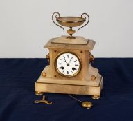 LATE VICTORIAN WHITE ALABASTER AND GILT METAL MANTEL CLOCK, of architectural form with two handle