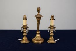THREE SIMILAR, MODERN CAST BRASS ELECTRIC TABLE LAMP BASES, one of tapering form with leaf cast