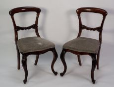 SET OF SIX VICTORIAN CARVED ROSEWOOD SINGLE DINING CHAIRS, each with a curved shoulder board and