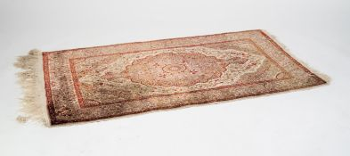 FINE QUALITY EASTERN SILK RUG WITH BLUE AND OFF-WHITE SHAPED OVAL LARGE CENTRE MEDALLION WITH