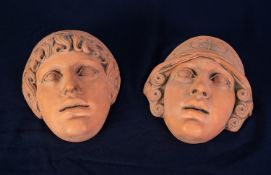 PAIR OF HEAVY TERRA COTTA CLASSICAL MALE AND FEMALE WALL MASKS, 9 1/2in (24cm) high, with raised