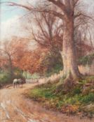 *JAMES WILLIAM STAMPER (1873-1947) OIL PAINTING ON CANVAS Man leading a horse down a country lane