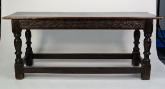 SEVENTEENTH CENTURY AND LATER CARVED DARK OAK LARGE SIDE OR REFECTORY TABLE, the later top above a