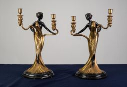 A PAIR OF TWENTIETH CENTURY POLISHED AND DARK LACQUERED BRASS TWIN BRANCH FIGURAL CANDELABRA on