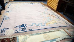 EARLY 20th CENTURY LARGE CHINESE CARPET, plain mauve field with multi-coloured pagoda and
