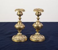 PAIR OF 19th CENTURY EMBOSSED AND CAST BRASS CANDLESTICKS, having floral or foliate decorative