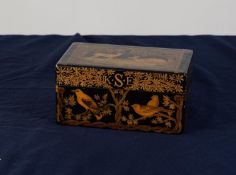 EARLY TWENTIETH CENTURY BLACK LACQUERED AND PENWORK DECORATED JEWELLERY BOX, of typical form the