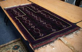 SHIRAZ, PERSIAN GEOMETRICAL PRAYER RUG with three rows of white stencilled hexagonal medallions with