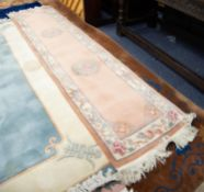 HEAVY QUALITY EMBOSSED WASHED CHINESE RUNNER, the plain peach coloured field decorated with two