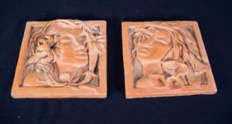 PAIR OF TERRA COTTA SQUARE WALL PLAQUES embossed in high relief with female heads in Art Nouveau