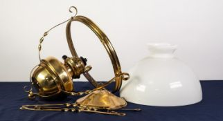 EARLY 20th CENTURY BRASS CEILING SUSPENDED OIL LAMP with opaque white glass shade