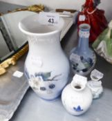 A SET OF FOUR VAROUS SIZE ROYAL COPENHAGEN VASES, DECORATED WITH BRAMBLES AND BLOSSOMS