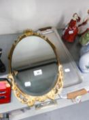 A SMALL OVAL WALL MIRROR WITH ORNATE GILT FRAME AND A LONG NARROW METAL TRAY WITH WOOD HANDLES