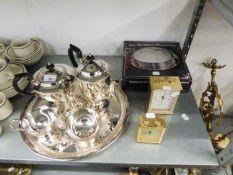 A FOUR PIECE ELECTROPLATE TEA SET, A CIRCULAR TRAY, AN E/P SUGAR SHAKER, SEVEN SILVER PLATE CIRCULAR