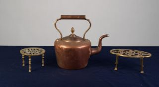 VICTORIAN COPPER KETTLE AND TWO PIERCED BRASS TRIVETS (3)