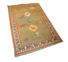 EASTERN CARPET with three small diamond shaped pole medallions featuring three animals, on a green