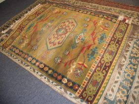 NEW ZEALAND, WOOL, MACHINE WOVEN BORDERED RUG of Caucasian design, having central medallion with