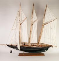 POST-WAR PROPRIETORY PAINTED WOOD MODEL OF A THREE MASTED AND STEAM POWERED SCHOONER, with fabric