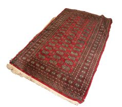 PAKISTAN BOKHARA RUG with two rows of guls on a crimson field 5ft x 3ft 1in (152.4 x 93.9cm) and
