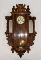 EARLY TWENTIETH CENTURY WALNUT CASED VIENNA WALL CLOCK WITH ADDITIONAL/ LATER SIDE PIECES, the clock