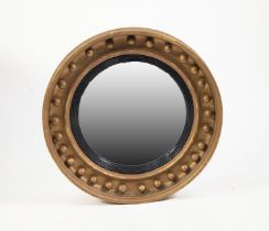 19th CENTURY GILT CONVEX MIRROR, the circular cavetto frame applied with balls and with an